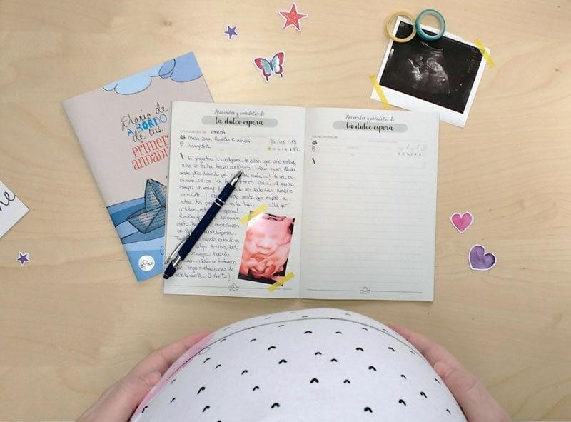 Diario de bebé con tripa de embarazo